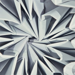 Keith Lam and his studio Dimension+'s Mutual Symphony, a kinetic origami kinetic sculpture that shrinks away from touch.