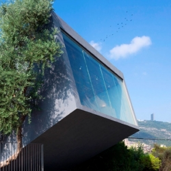 The Nesher Memorial auditorium and gallery in Nesher, Israel by SO Architecture.