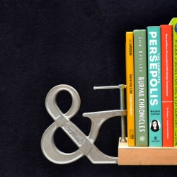 The Adjustable Clampersand, an ampersand shaped bookend from Core77 that originated from a Coretoon by Tony Ruth.