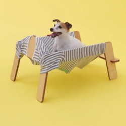 Wanmock, a hammock for dogs from Torafu Architects that incorporates some of it's owner's clothing.