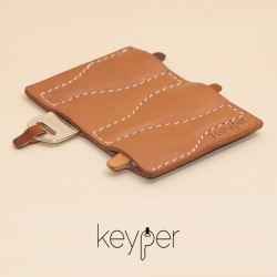 Keyper is the slimmest leather key organizer to safekeep your keys. Handcrafted from genuine calf leather, Keyper is designed to snuggly store, organize and protect your keys.