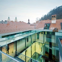 The Slovenian firm OFIS Arhitekti transformed three Baroque houses in Ljubljana into an apartment block with a secret courtyard, beautiful!