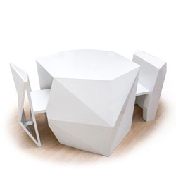 A-Cute, designed by London design firm AndViceVersa, a table and set of chairs that tuck in to form a single multifaceted sculpture.