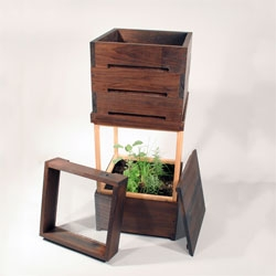 This is a designer worm bin and planter.  Made with kiln treated poplar to create a mold resistant vessel for composting food scraps.  Made by Michael Koliner and Ryan Hammond