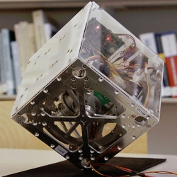 Cubli, a cube containing flywheels from the Institute for Dynamic Systems and Control at ETH Zurich that can balance itself and walk across surfaces.