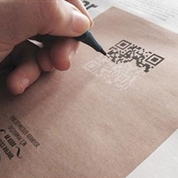 Playful ad campaign for a tattoo parlor in which would-be tattoo artists color in a QR code.
