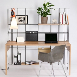A desk and shelving unit in DIN Desk from Gompf & Kehrer.