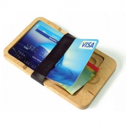 Wood Wallet uses a credit card as a lid for a small chamber for money bills and coins.  It has room for 4 cards on top of each other.
