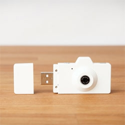 The tiny Superheadz Clap Camera is a 2 megapixel camera and memory card reader.
