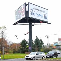 Vojtěch Fröhlich, Ondřej Mladý, Jan Simánek, and Vladimír Turner transform a rotating billboard into a merry go round ride in their project 'kolotoč.
