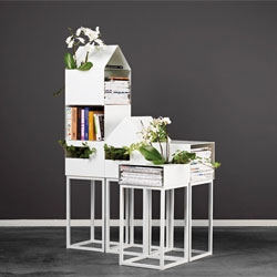 Street, a stackable storage unit composed of four parts: a frame and a house, high and low unit. Designed by A2.