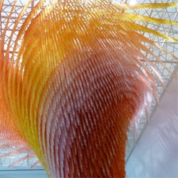 Stunning images of Do Ho Suh's 'Cause & Effect'. An enormous orange vortex composed of tiny orange men.