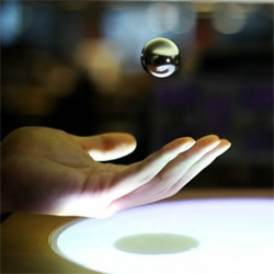 ZeroN, a physical and digital interaction element that floats and moves in space by computer-controlled magnetic levitation. Created by Jinha Lee, in collaboration with Rehmi Post, and Hiroshi Ishii.