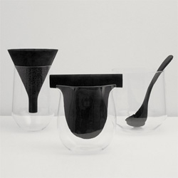 Charcoal by Formafantasma at the Vitra Design Museum. The Charcoal inserts purify tap water in these blown-glass containers by Italian designer Formafantasma.