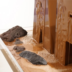 Art in chocolate-like methyl cellulose . Doug Aitken's fountain installation at Art Basel 2012.