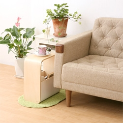 The ideaco RACK&STOOL helps keep your living room tidy and provides another surface.