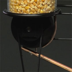 The Uncle Sam machine from ECAL processes grains one by one, focusing on the transformation of corn into popcorn, one kernel at a time.