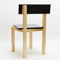 The Portrait Chair by Akio Haykawa whose back support and seat are slightly shifted to the side, offering an alternative siting experience.