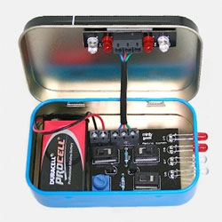The Astronomer's Torch Minty Geek kit. The solder your own kit creates a controllable light source with both red and white light, all packed in a retro mint tin.