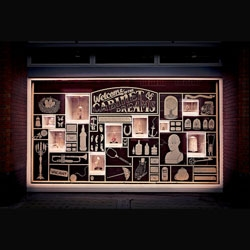 The Cabinet of Dreams, a virtual Valentine's charity shop for Women's Aid with a street level window in London's Soho created by Grey London. The window is full of miniature installations in bell jars including Kyle Bean, Rob Ryan and Charlotte Brown.