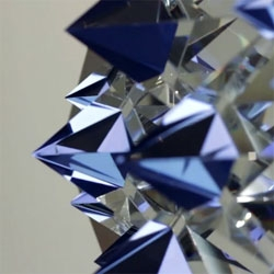 Kit Webster's Prismatica installation of pyramid-shaped crystals affixed to an LCD screen and illuminated with programmed geometric animations.