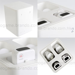Crazy super sleek white (or black) cube like container for wiimotes and nunchucks by brando... complete with spring action... too bad no charging.