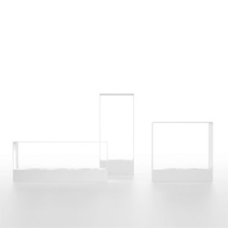 The Liar fireplace collection by Borja García for Gandia Blasco. The minimalist framing reminds me of aquariums!