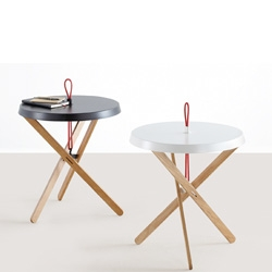 Marionet by Simon Busse, a side table, which like the marionette is connected by strings.