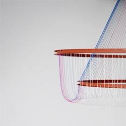 Susanne de Graef's The rhythm of light for La Chance a chandelier that rises and sets.