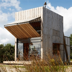 Whangapoua Sled House by Crosson Architects is a beach house on sleds!
