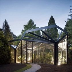 The stunning Greenhouse at Grüningen Botanical Garden by Buehrer Wuest Architekten.