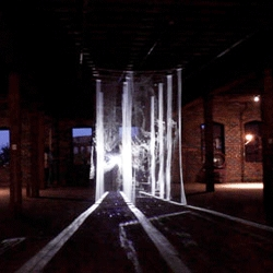 Transient by Pablo Gnecco is a temporary light installation for the group exhibition Tangled Up In My Friends at Nelson Street Gallery created using 16 yards of hanging staggered tulle, a looping video, and an overlay of a live image from the Kinect.