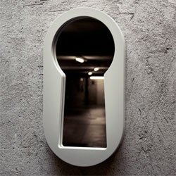 The keyhole-shaped Voyeur Mirror  by Italian design studio BBMDS..