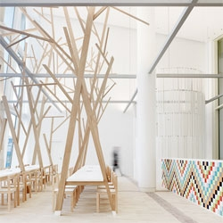 Cantina by Estudio Nômada features tree-like wooden structures rising from the tables.