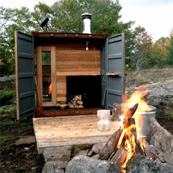 A tradtional wood-burning sauna built inside a shipping container by Castor.