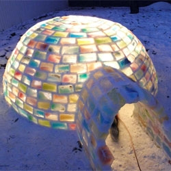 Awesome colorful backyard igloo created with milk cartons in Edmonton, created by Daniel Gray and Kathleen Starrie.
