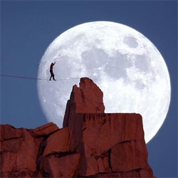 Stunning tightrope walking before a full moon.  Dean Potter walks a highline at Cathedral Peak as the sun sets and the moon rises as part of a larger National Geographic series.