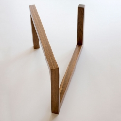 The Momento Table by Roberto & Stefano Truzzolillo  with a twist in its wooden frame to support a glass tabletop.