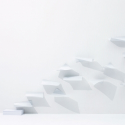 The Blow, a wall shelf inspired by paper blowing in the wind. Designed by YOY.