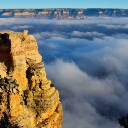 A temperature inversion at the Grand Canyon creates a sea of clouds and captured by Paul Lettieri.
