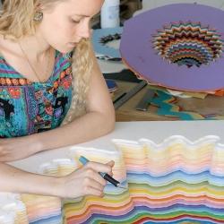 Contemporist interviews Jen Stark who makes intricate paper sculptures.