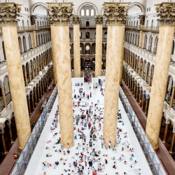 Snarkitecture turn the Great Hall of the National Building Museum in DC into The Beach with an ocean of 750,000 recyclable plastic balls.