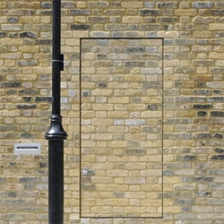 Architect Jack Woolley's 'Old Warehouse' has its entrance camouflaged into an old brick wall.