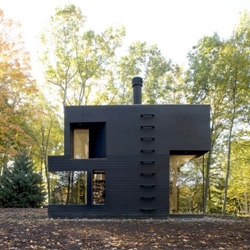 A writer's studio tucked away in the woods of Ghent, New York by Cooper Joseph Studio.