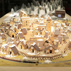 MUJI's interactive installation of 100 gingerbread houses with a live feed of the store from tha!