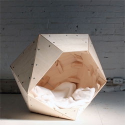 A DIY Geometric Doghouse from HomeMade Modern.