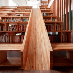 The Panorama House designed by Moon Hoon. Love the slide in the library!