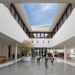 Dai-ichi Yochien in Kumamoto City, a preschool with an open roof and design that forms puddles perfect for splashing in when it rains.
