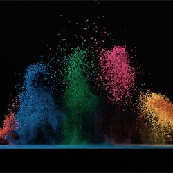 Fabian Oefner's Dancing Colors series captures color pigments dancing on a speaker.