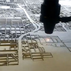 The process of laser cutting maps by CutMaps .